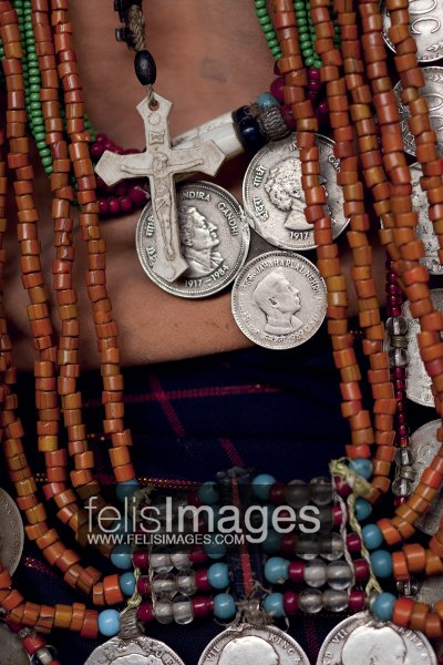 with the advent of to the region in the 1840s many naga were converted and now wear a holy cross amidst more traditional bead necklaces